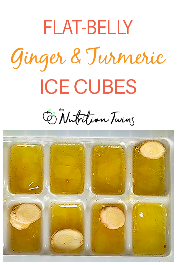Ginger and Turmeric ice cubes in tray wih slices ginger